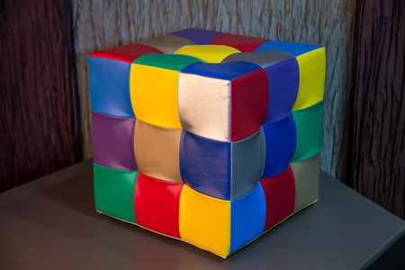 Rubiks cube chair with multicoloured leather squares Editorial