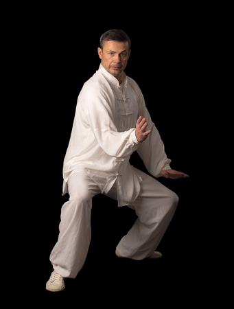 wushu: Karate fighters. Training fight. Located on the black background.