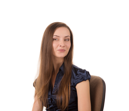 tricky: Portrait of beautiful young woman sitting on a chair and smiling tricky, white background