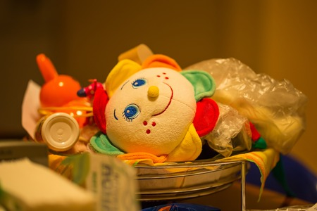 stuffed toys: A closeup of lovely baby things such as stuffed toys and a bottle and a babys rattle