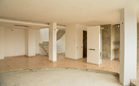 condominiums built: An empty interior of a newly built apartment with white walls Stock Photo