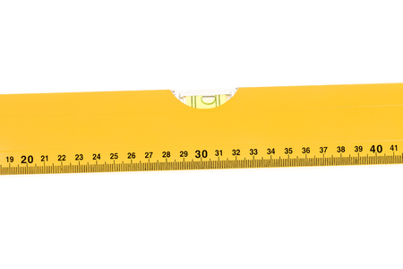 yellow block: Yellow block level meter with bubble. Isolated on a white background.