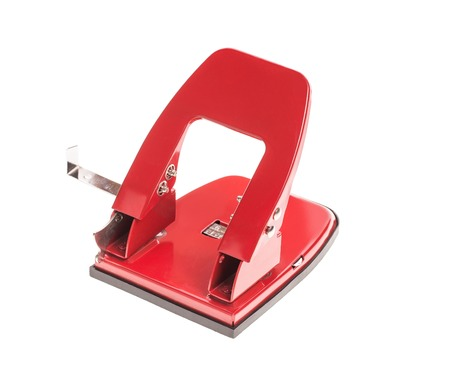 puncher: Red office hole puncher. Isolated on a white background.