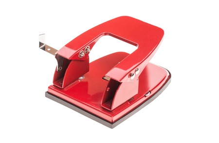 hole puncher: Red office hole puncher. Isolated on a white background.