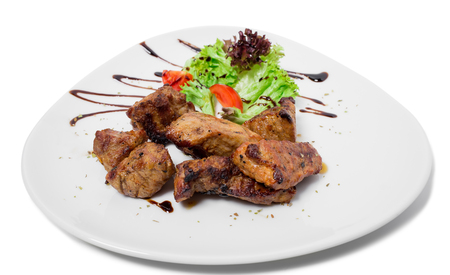 kabob: Delicious lamb shish kebab with tomatoes. Isolated on a white background.. Stock Photo