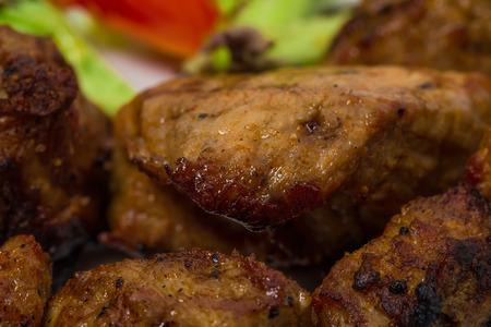 kabob: Delicious lamb shish kebab with tomatoes. As a whole background. Stock Photo
