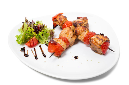 kabob: Delicious shish kebab on skewers. Isolated on a white background.