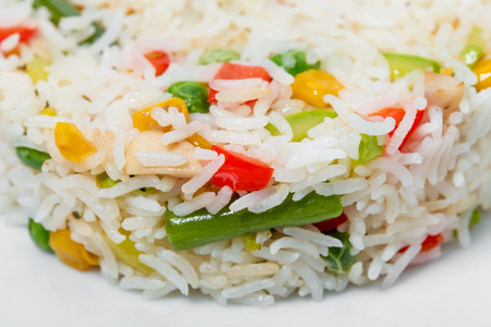 Long white rice with vegetables. As a whole background. Stock Photo