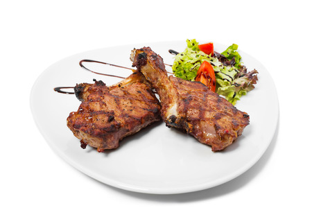meat sauce: Grilled steaks with vegetables. Isolated on a white background. Stock Photo