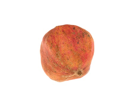 rotten fruit: Rotten pomegranate fruit. Isolated on a white background.