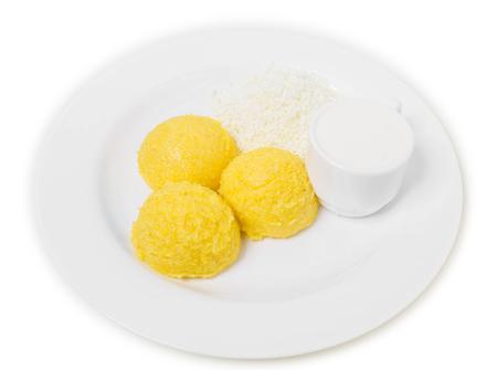 moldovan: Traditional moldovan mamaliga porridge. Isolated on a white background. Stock Photo