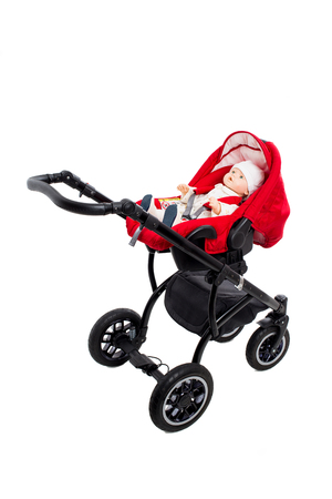 modern doll: New red modern pram with doll. Side view. Isolated on a white background.