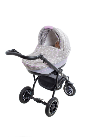 modern doll: New gray modern pram with doll. Side view. Isolated on a white background.