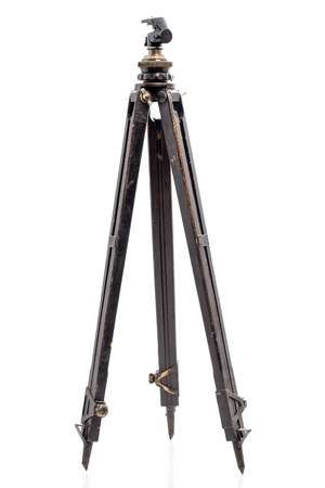 stabilization: Old expedition oaken wooden tripod. Isolated on a white background. Stock Photo