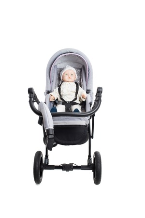 modern doll: New gray modern pram with doll. Front view. Isolated on a white background.