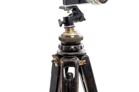 oaken: Closeup of old expedition oaken wooden tripod. Isolated on a white background.