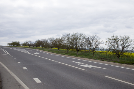 main: Main road. Landscape of main road stretches into the distance.
