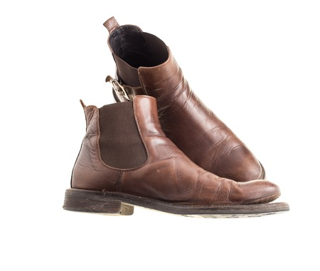 chelsea: Stylish old chelsea leather boots. Isolated on a white background Stock Photo