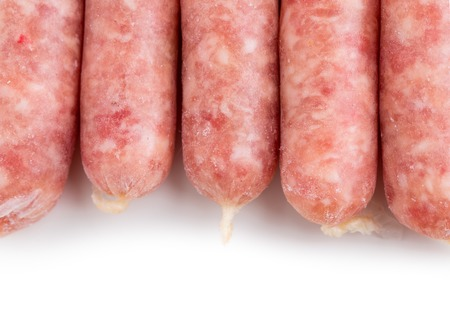 raw pork: Delicious raw sausages for barbecue. Macro. Isolated on a white background. Stock Photo