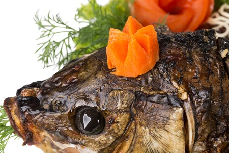 sturgeon: Head of baked sturgeon with vegetables. Macro. Photo can be used as a whole background. Stock Photo