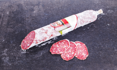 penicillium: Delicious italian felino salami stick. Located on black cardboard background.