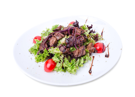 kabob: Grilled veal shish kebab with red onions covered with soya sauce on fresh lettuce leaves and tomatoes cherry. Isolated on a white background.