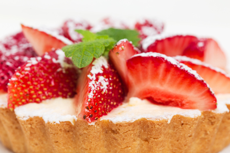 shortcake: Delicious strawberry shortcake with whipped cream and fresh mint. Macro. Photo can be used as a whole background. Stock Photo