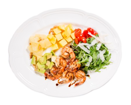 jumbo shrimp: Jumbo shrimp salad with avocado mango topped with pine nuts and parmesan cheese. Isolated on a white background.