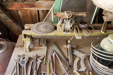 carpenter's bench: Old rusty work table with various tools. Photo can be used as a whole background. Stock Photo