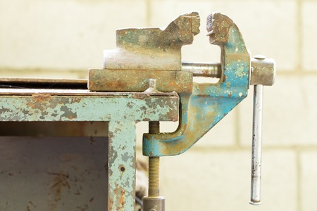 vise: Old bench metal vise in the workshop. Stock Photo