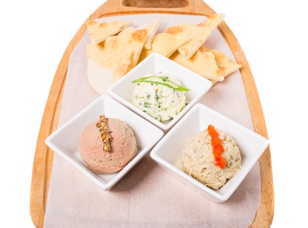 antipasto platter: Antipasto platter with italian focaccia and delicious various pates. Isolated on a white background.