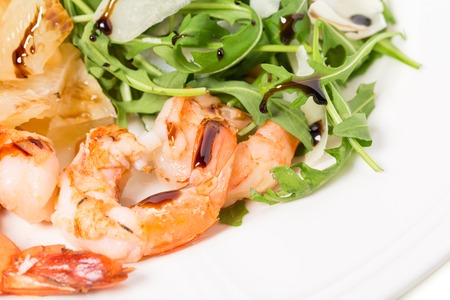 jumbo shrimp: Jumbo shrimp salad with arugula and mango topped with pine nuts and parmesan cheese. Macro. Photo can be used as a whole background.