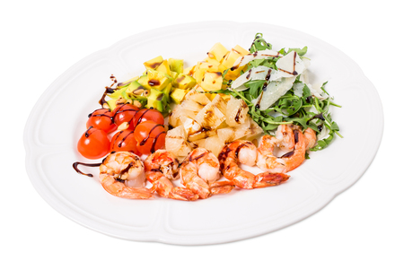 jumbo shrimp: Jumbo shrimp salad with avocado and mango topped with pine nuts and parmesan cheese. Isolated on a white background.