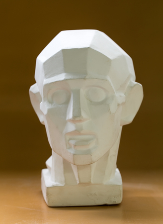 chins: Tutorial primitive plaster head model. Front view. Located against wall as a background.
