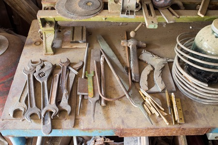 Old rusty work table with various tools. Photo can be used as a whole background. Stock Photo