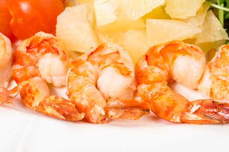 jumbo shrimp: Jumbo shrimp salad with tomatoes and pomelo topped with pine nuts and parmesan cheese. Macro. Photo can be used as a whole background.