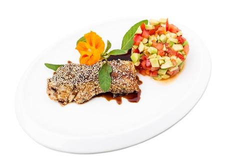 white perch: Perch fillet with tomato and avocado salsa covered with sesame seeds. Isolated on a white background.