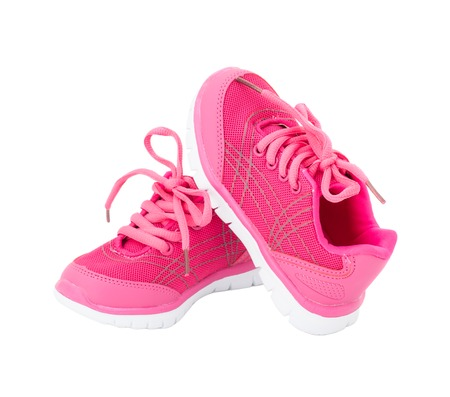 training shoes: Pair of pink training shoes for girls. Isolated on a white background.