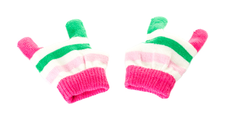 rock wool: Pair of pink and green wool mittens in form of rock sign. Isolated on a white background.