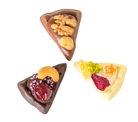 candied fruits: Mix of delicious chocolate pizza slices with nuts and candied fruits. Isolated on a white background.