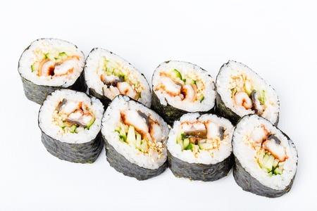 unagi: Delicious smoked unagi roll with cucumber and sesame seeds. Macro. Photo can be used as a whole background. Stock Photo