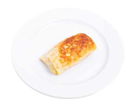 forcemeat: Russian pancake stuffed with pork forcemeat. Isolated on a white background.