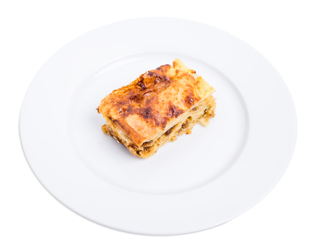 forcemeat: Baked pie with pork forcemeat. Isolated on a white background.