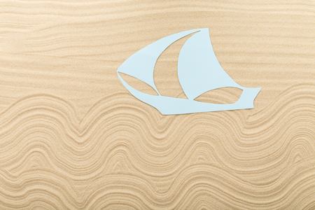 clipper: Paper clipper boat on waved sand. Photo can be used as a whole background.