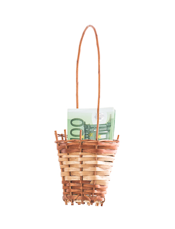 holiday profits: Wicker basket full of euro bills. Isolated on a white background.