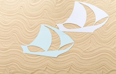 clipper: Paper clipper boats on waved sand. Photo can be used as a whole background.