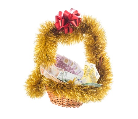 red bills: Wicker basket full of euro bills with christmas golden tinsel and red ribbon. Isolated on a white background. Stock Photo