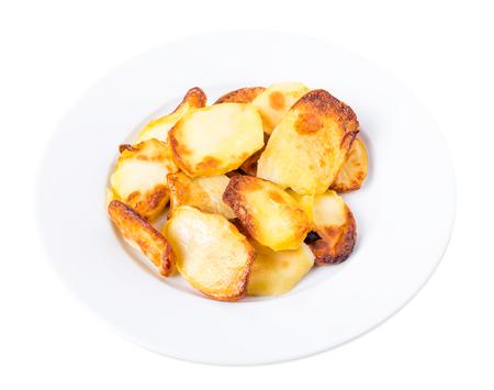roast potatoes: Traditional roast potatoes. Isolated on a white background.
