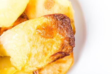roast potatoes: Traditional roast potatoes. Macro. Photo can be used as a whole background.