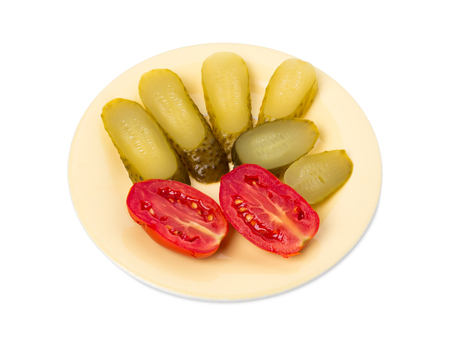Marinated cucumbers and tomatoes. Isolated on a white background.